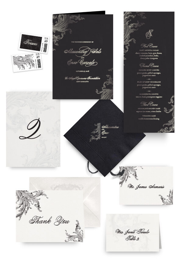Dark ornate napkins, table cards, escort and place cards