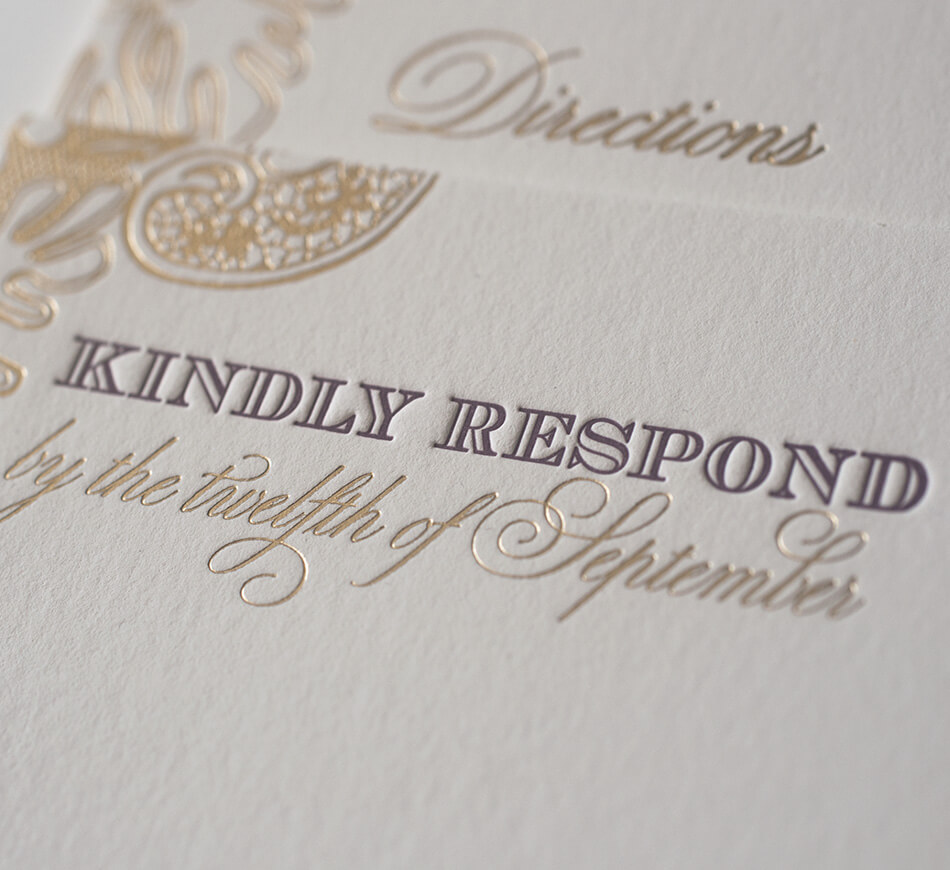 Gold and burgundy typography