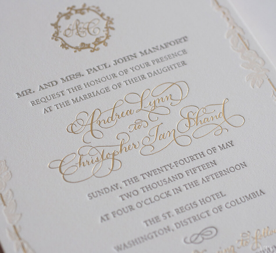 Gold calligraphy lettering on a classic invite