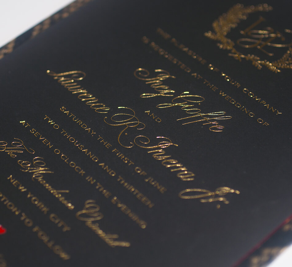 Gold lettering typography on a black invite