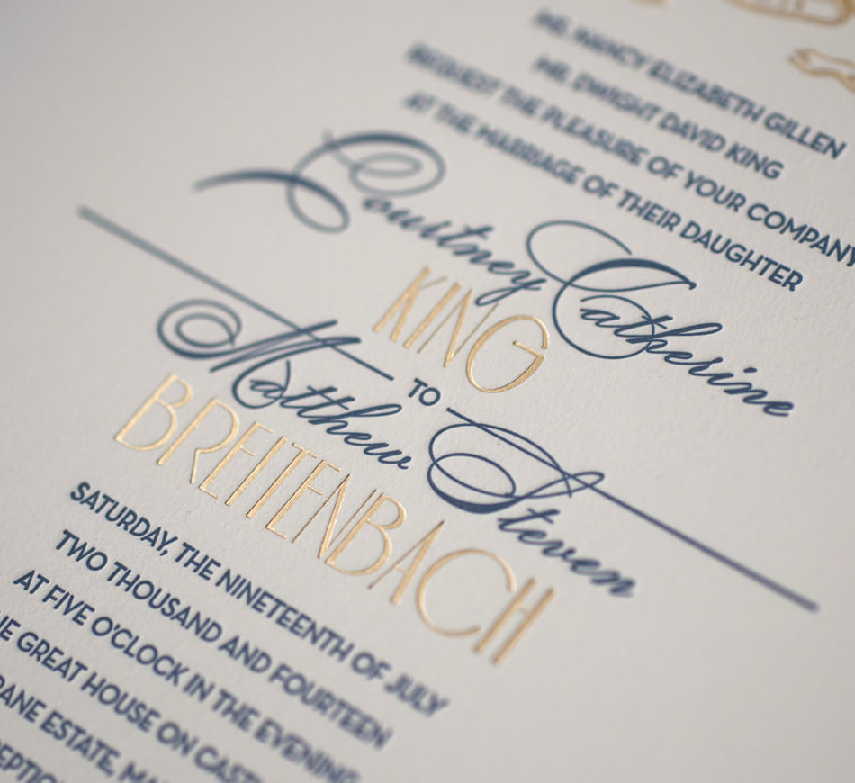 Gold foil and navy letterpress typography