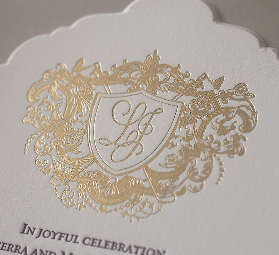 Gold foil stamped custom crest with roses, butterflies and golf clubs