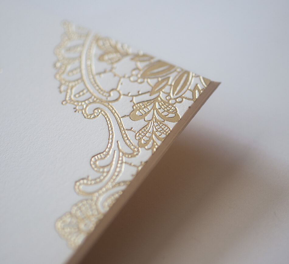Gold lace motif on the invitation corner