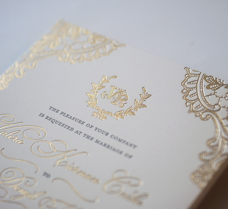 Gold monogram on invitation
