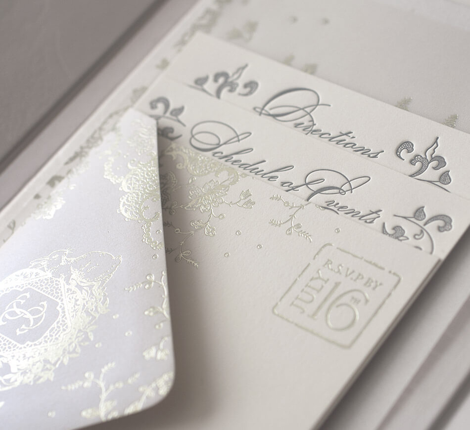 Letterpress and foil stamped enclosure cards