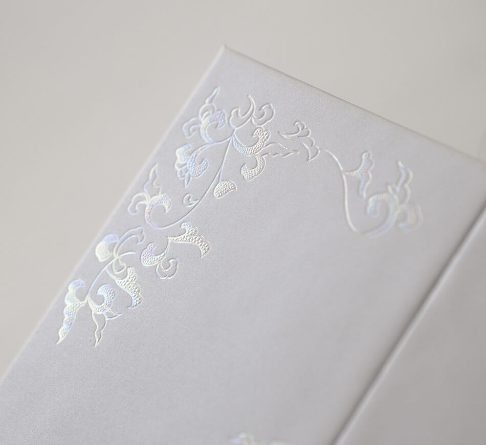 Mother of pearl wedding invitation detail