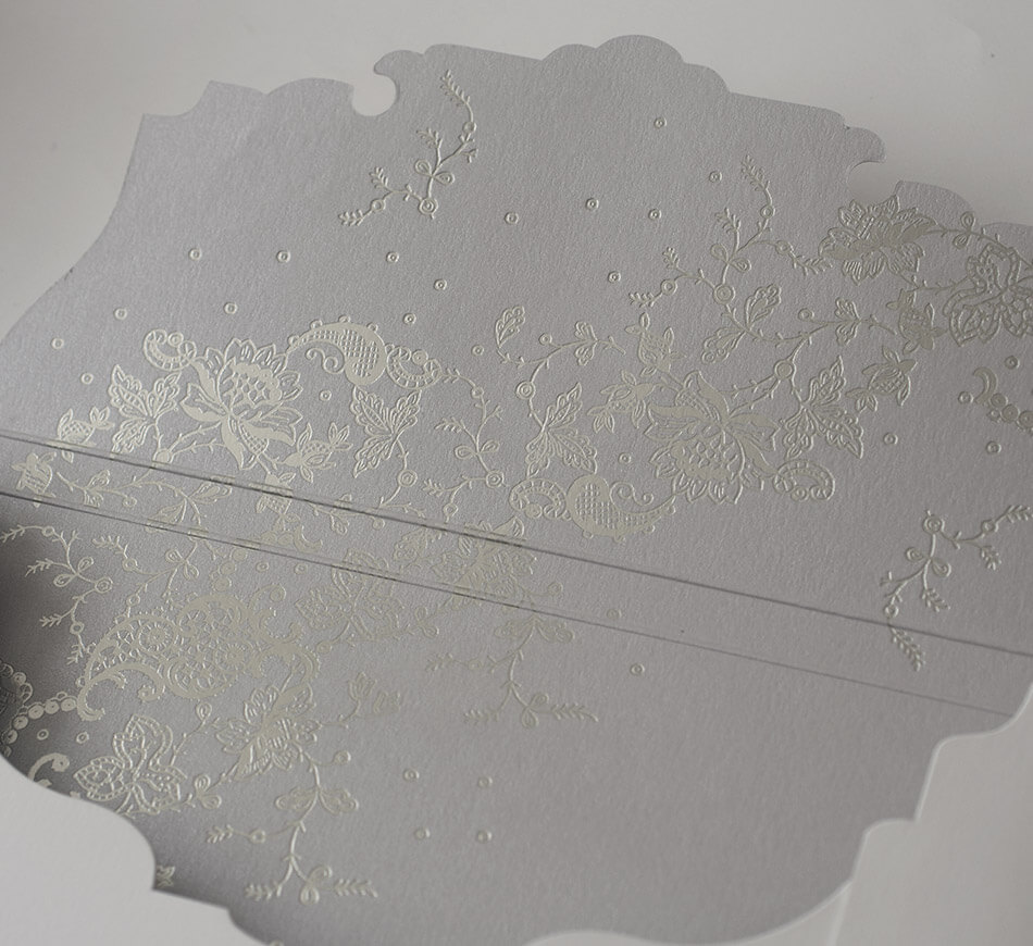 Silver foil stamped lace design on an envelope liner