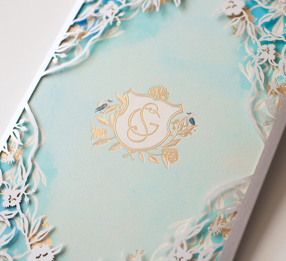 Watercolor and laser cut wedding invitation