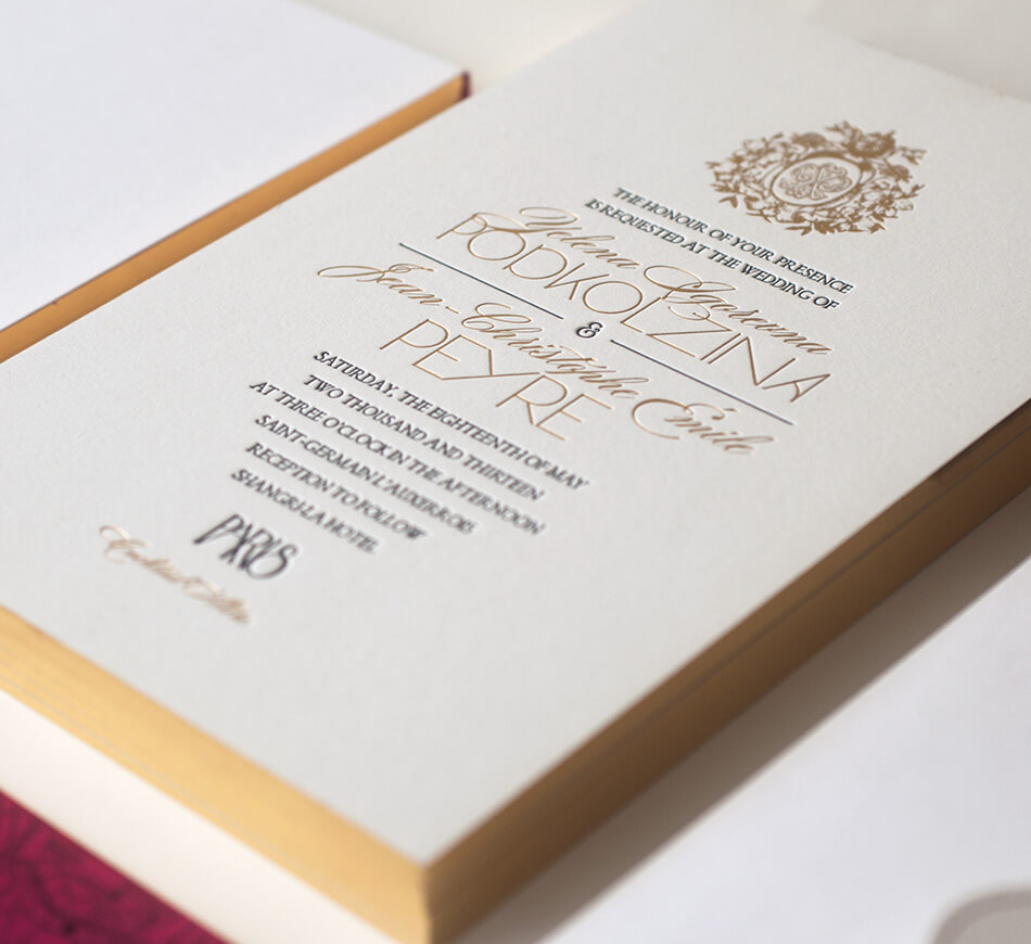 Contemporary wedding invitation with gold edges