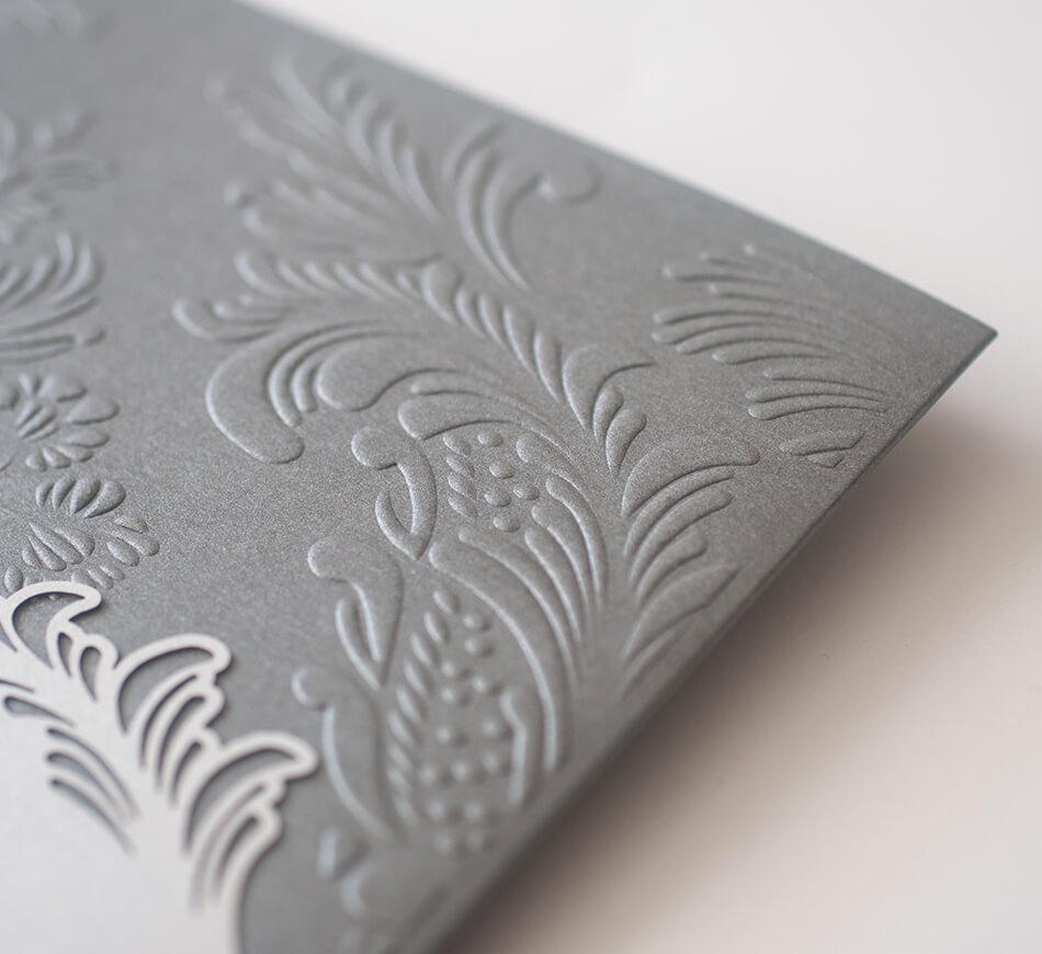 Embossed ornate flourishes