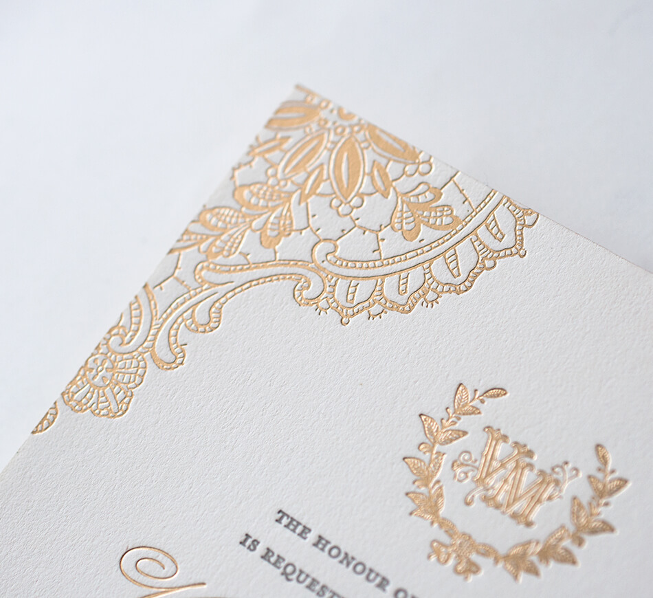 Gold foil lace detail on a letterpress invitation