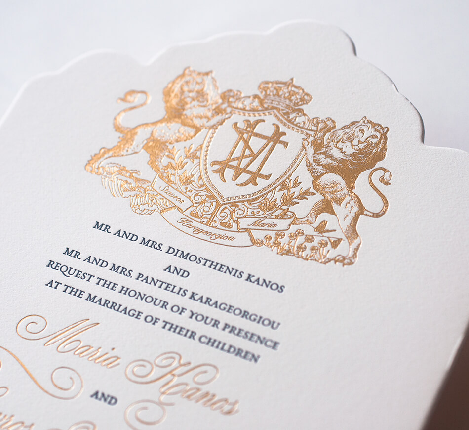 Gold foil lion crest on die cut invitation