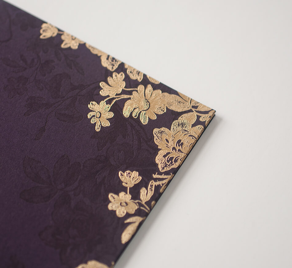 Gold foil and purple letterpress on a folder cover