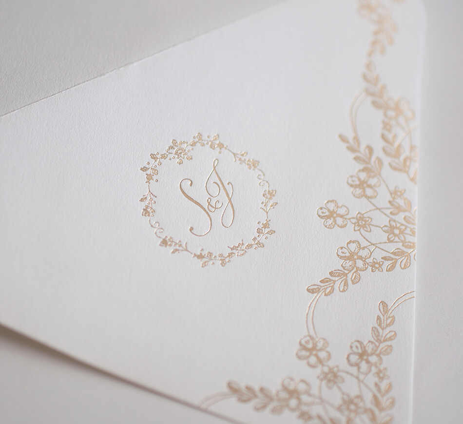 Gold foil stamped flowers and lettering