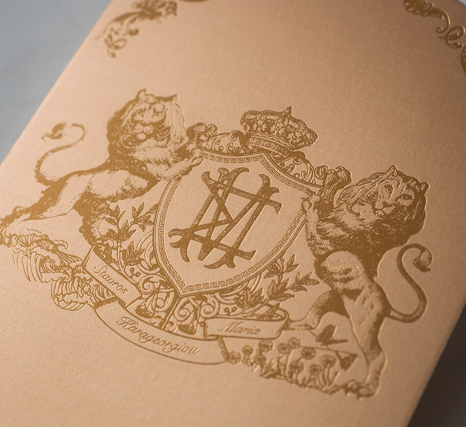 Gold on gold lion crest on back of invitation