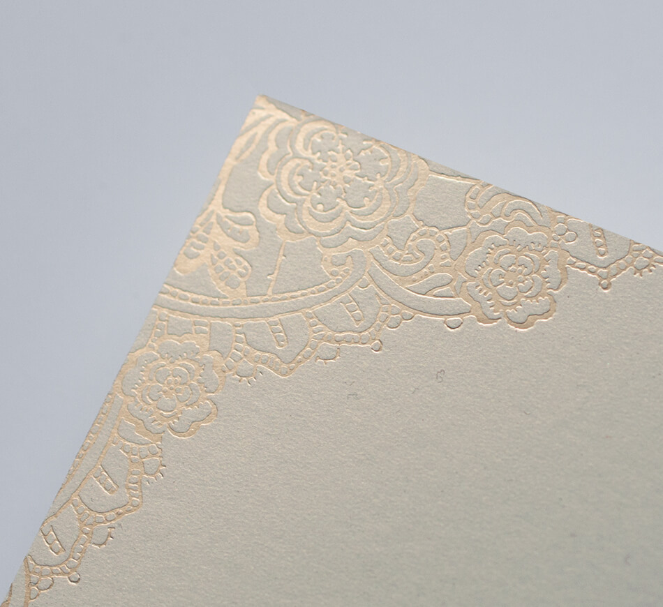 Lace detail printed in gold foil