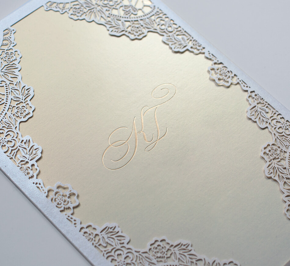 Lace laser cutting on an invitation sleeve