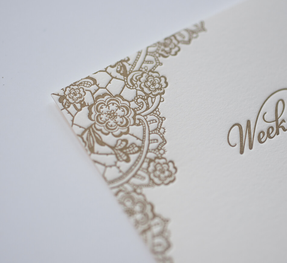 Letterpress corner detail on an events card
