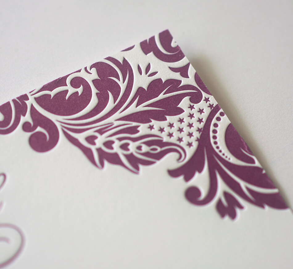 Letterpress scrollwork on reply card