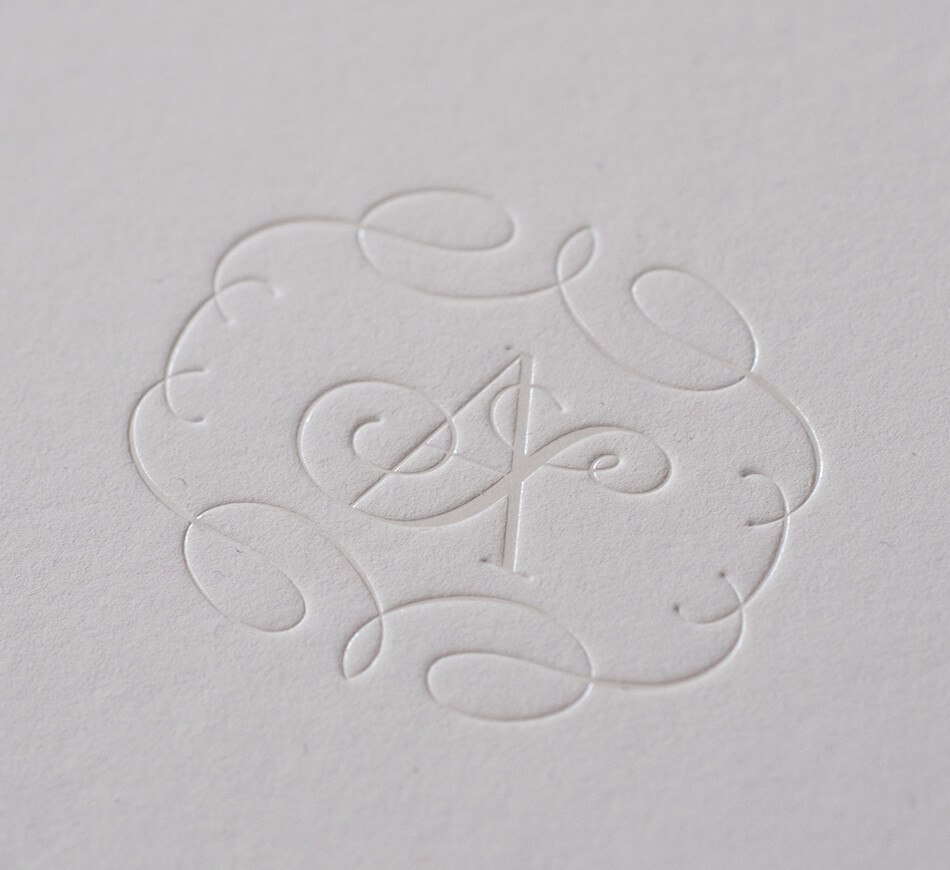 Pearl foil monogram and flourished border