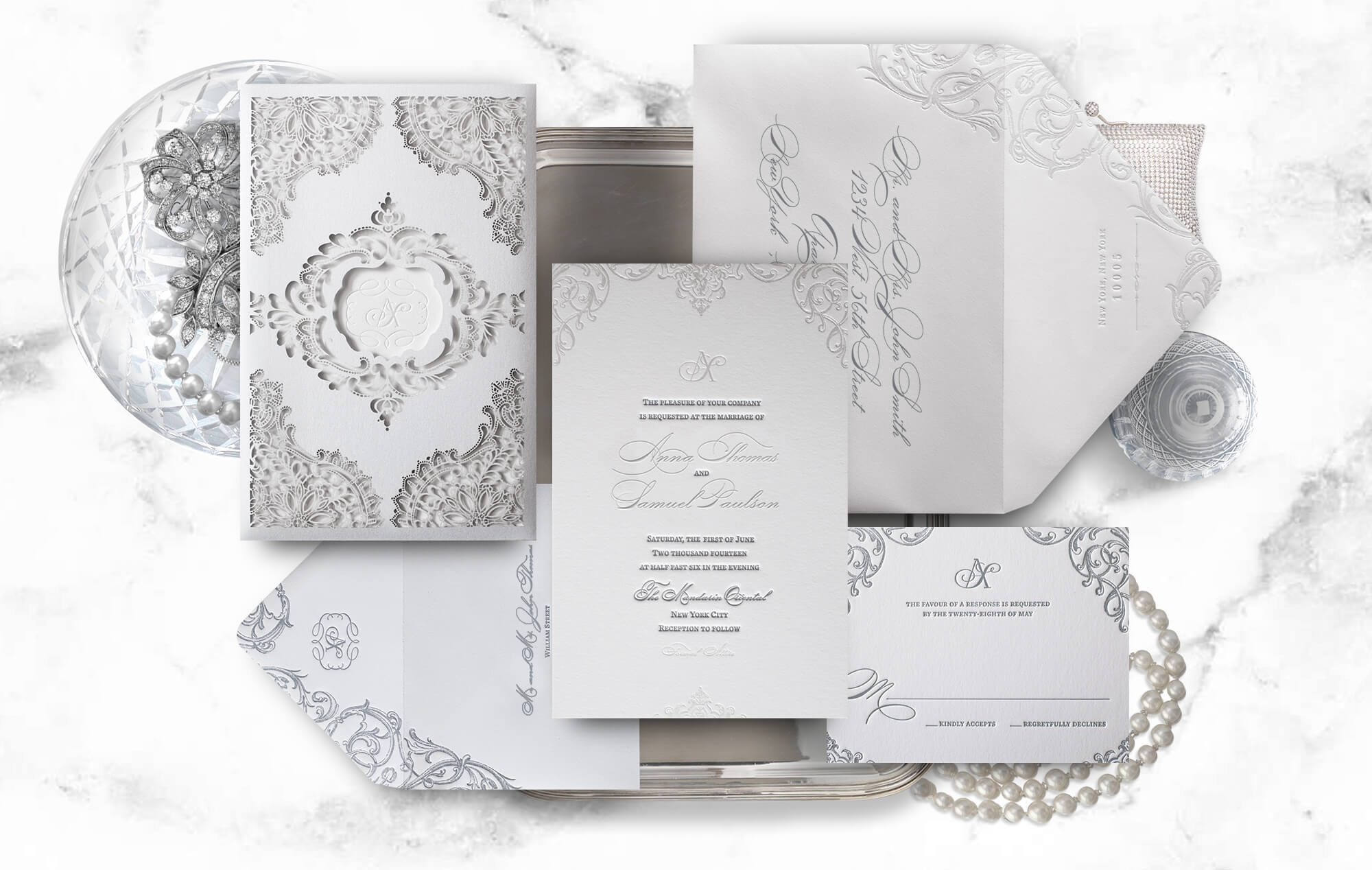 White wedding invitation with laser cut sleeve