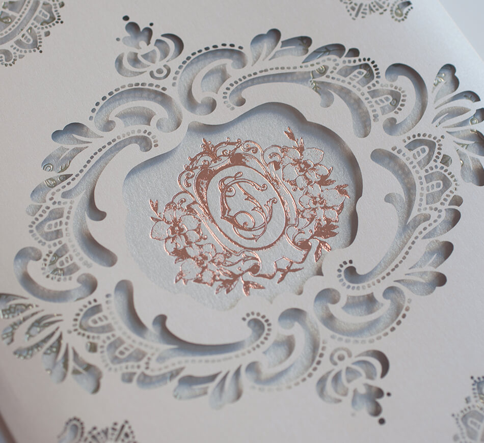 Laser cut lace wedding invitation detail