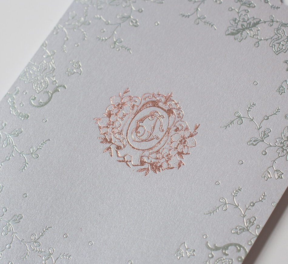 Rose gold crest and silver lace on wedding invitation
