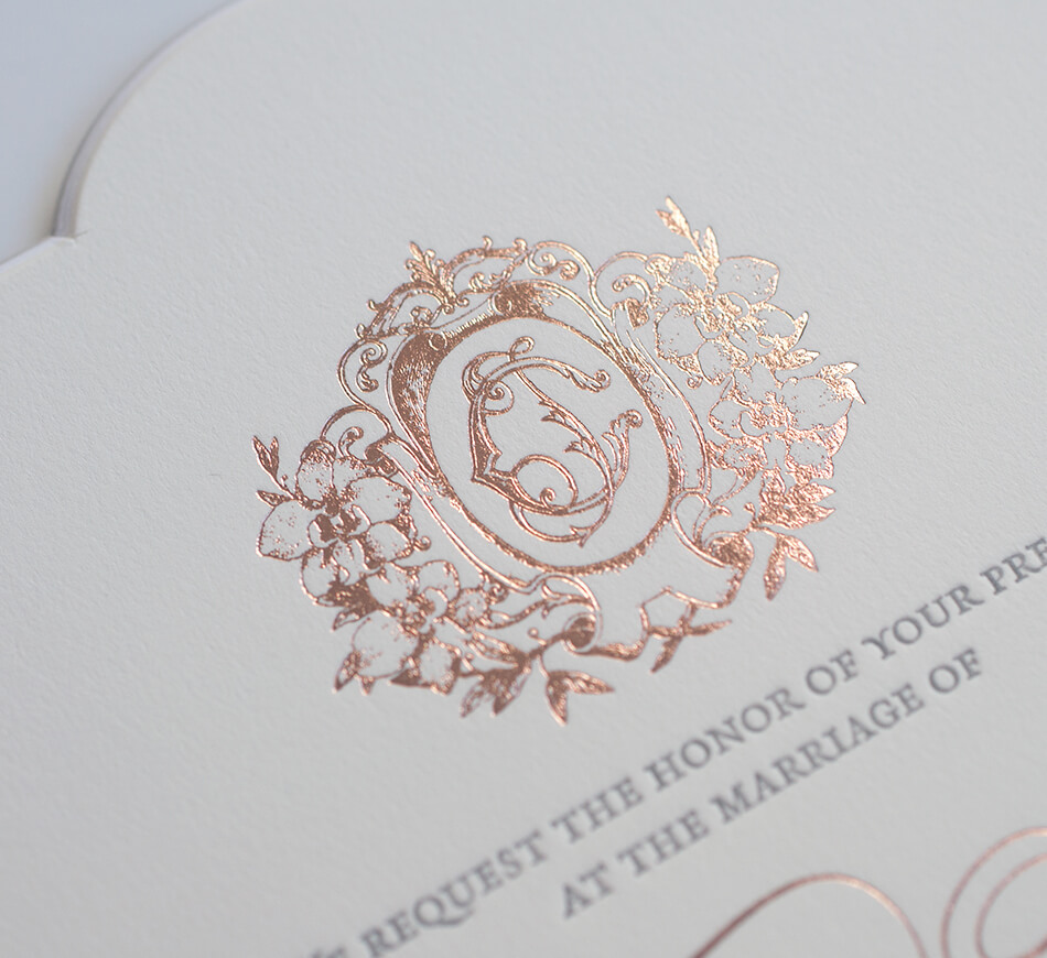 Orchid and monogram crest in rose gold foil