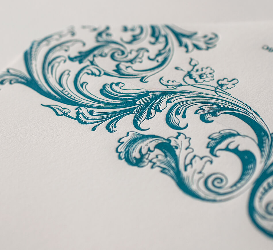 Teal scrollwork on envelope