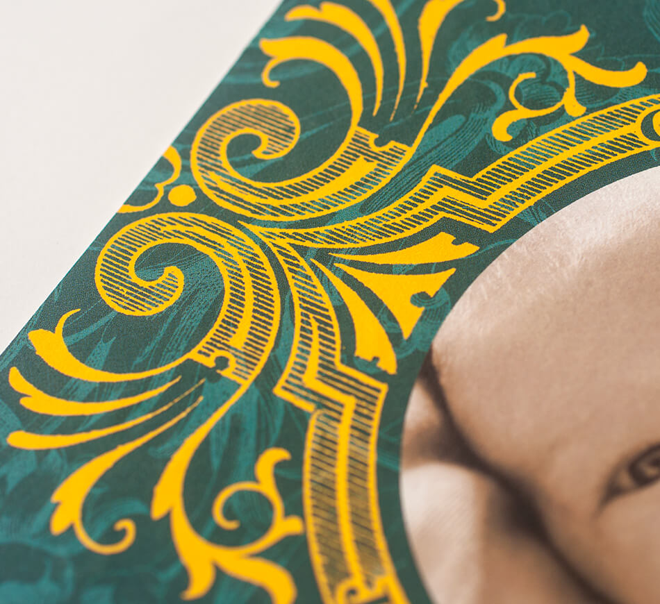 Yellow scrollwork on a teal announcement