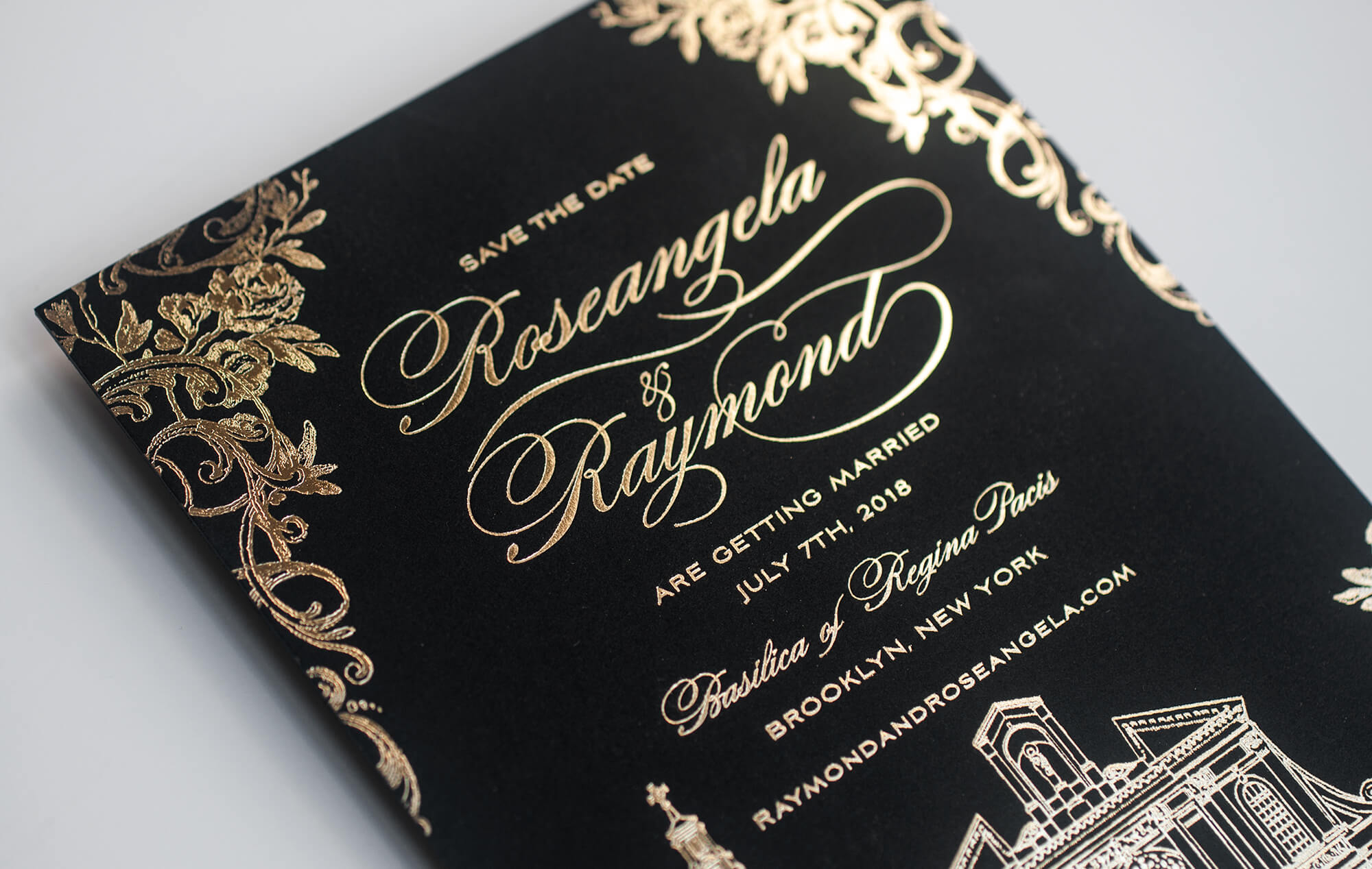 Gold lettering on a black save the date card