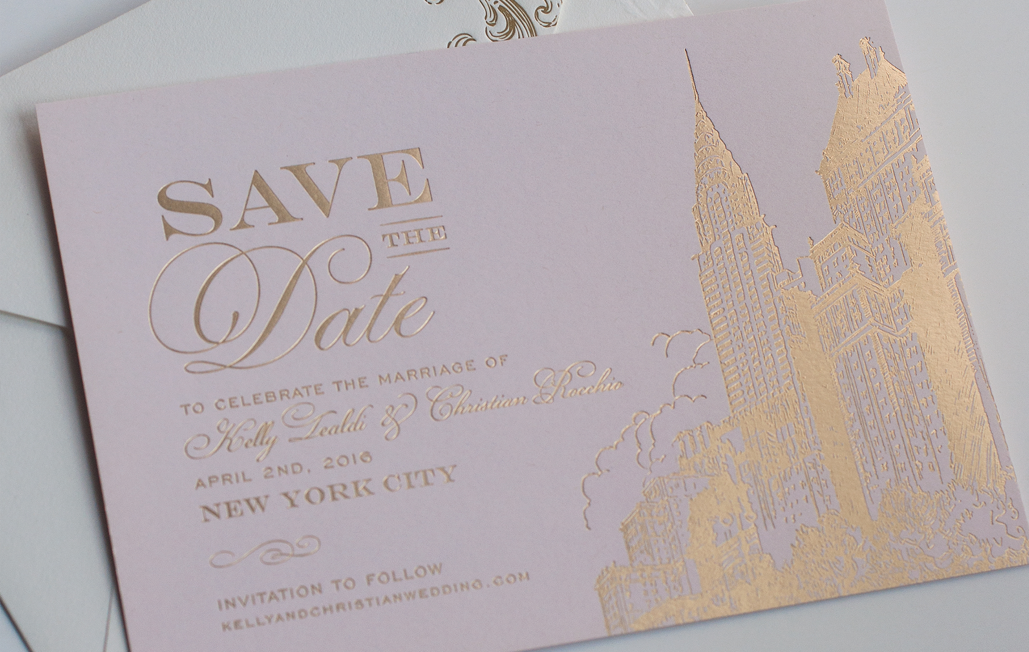 Gold skyline and Chrysler building on a pink save the date