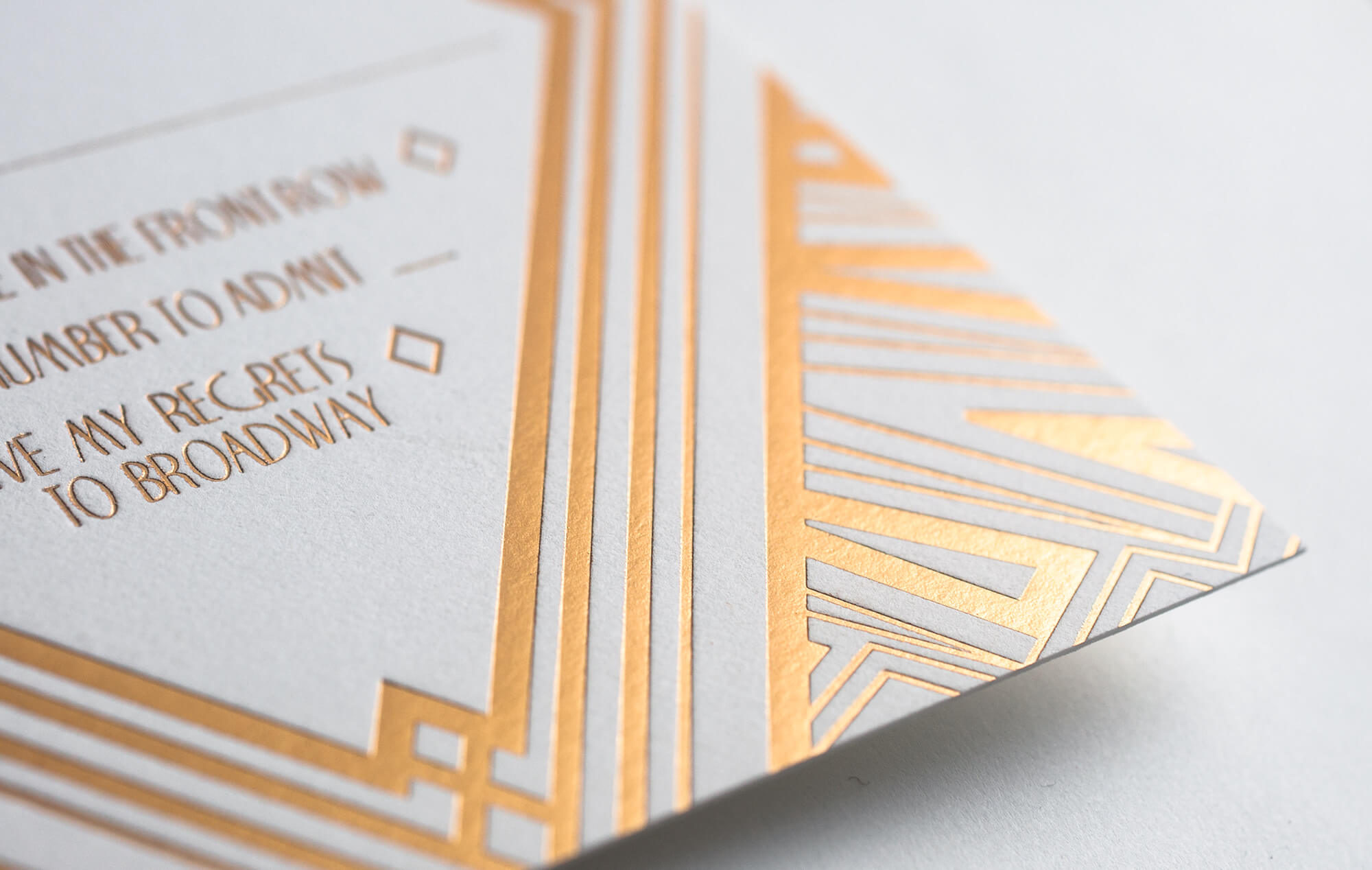 Gold foil art deco linework