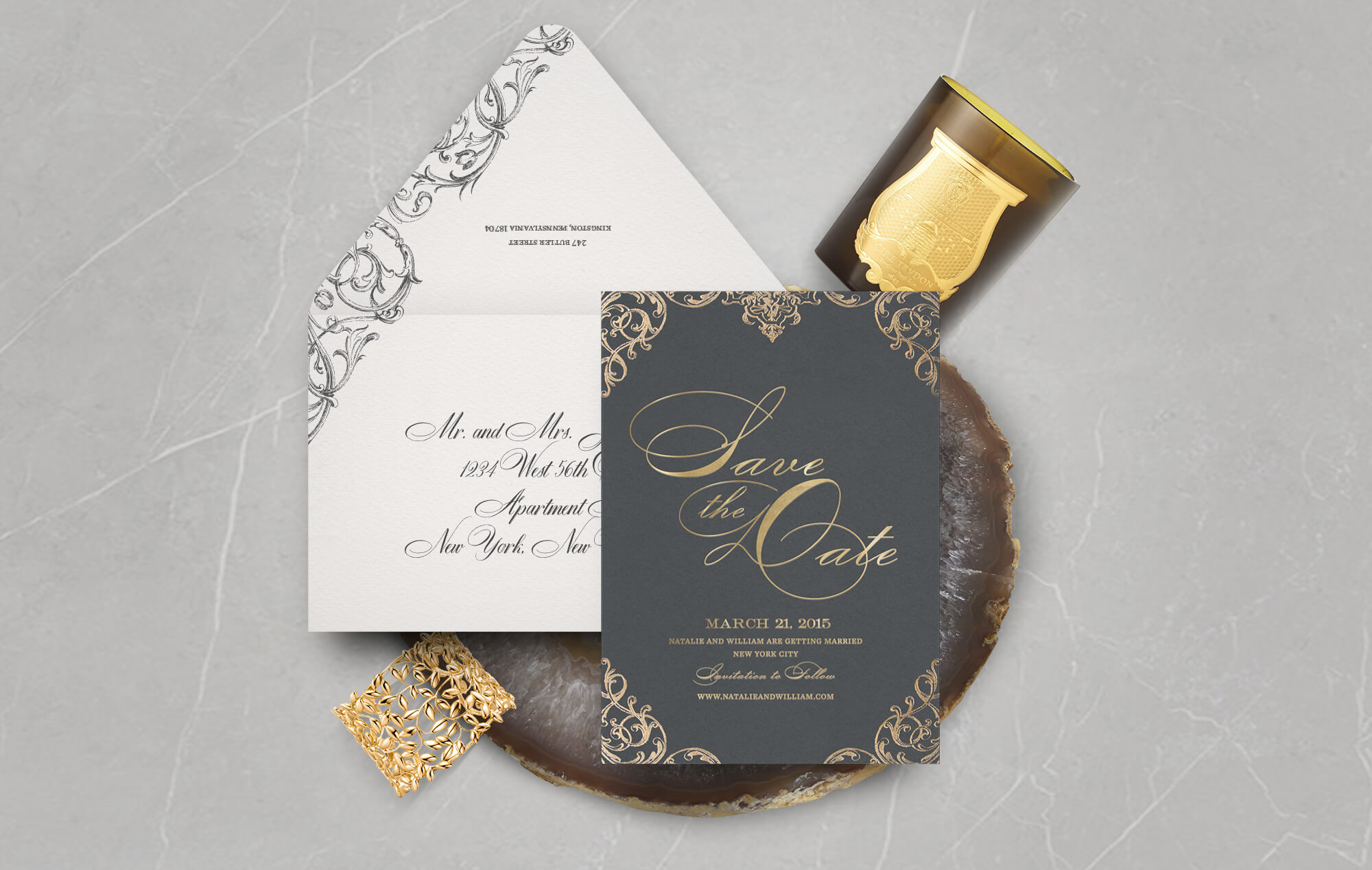 Gold and charcoal scrollwork save the date