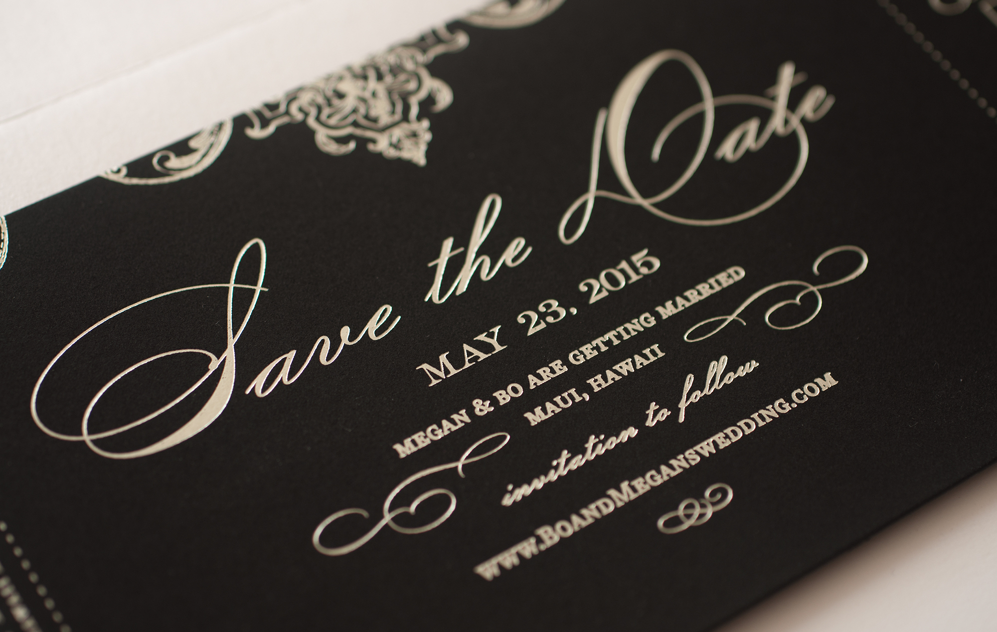 Silver foil stamping on black paper