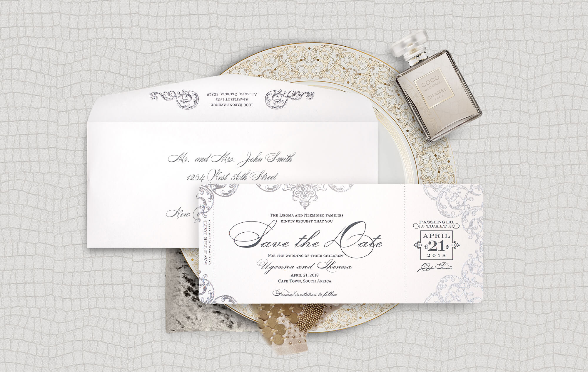 Ornate silver boarding pass save the date