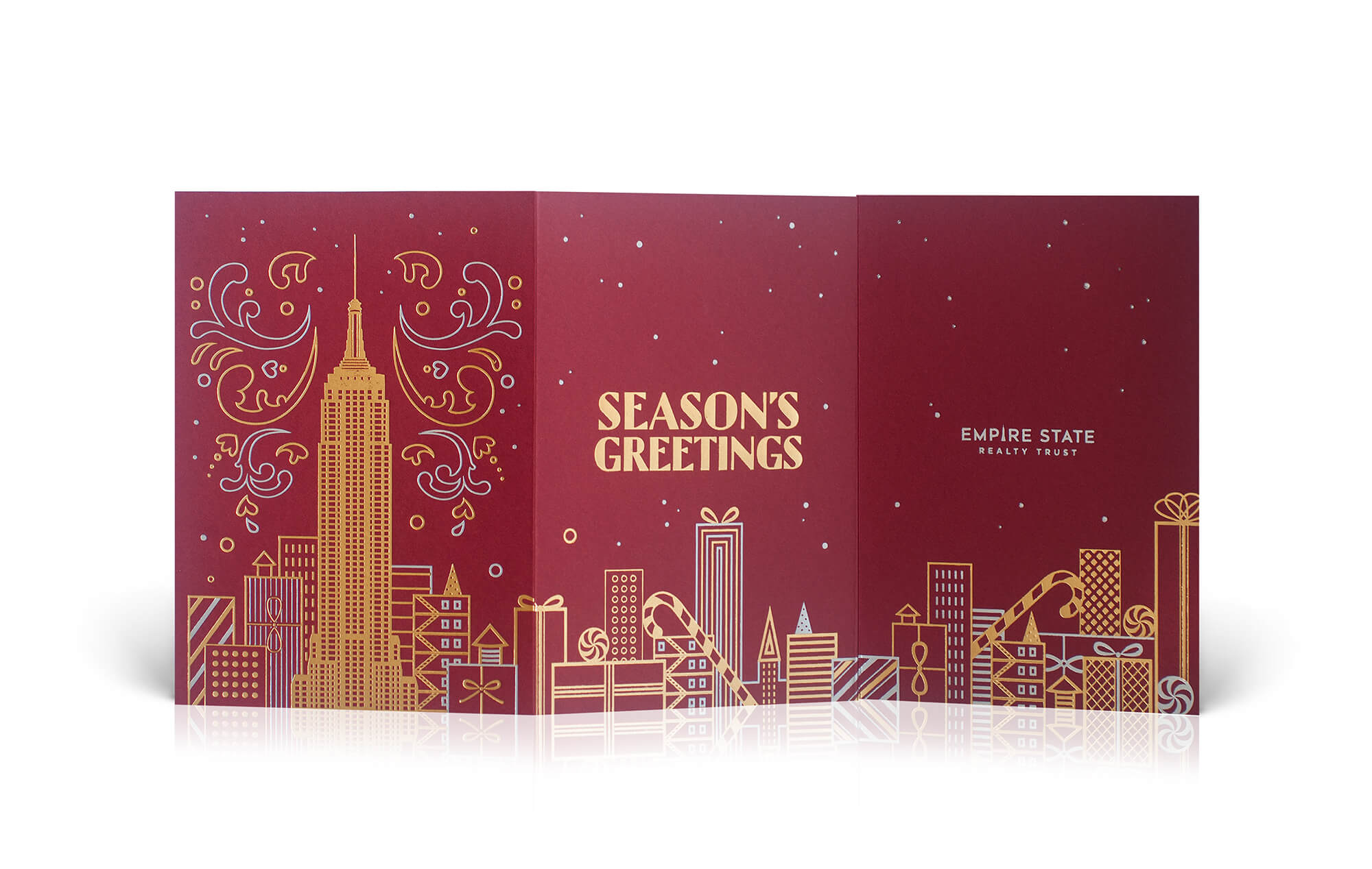 Holiday card with a festive skyline of presents