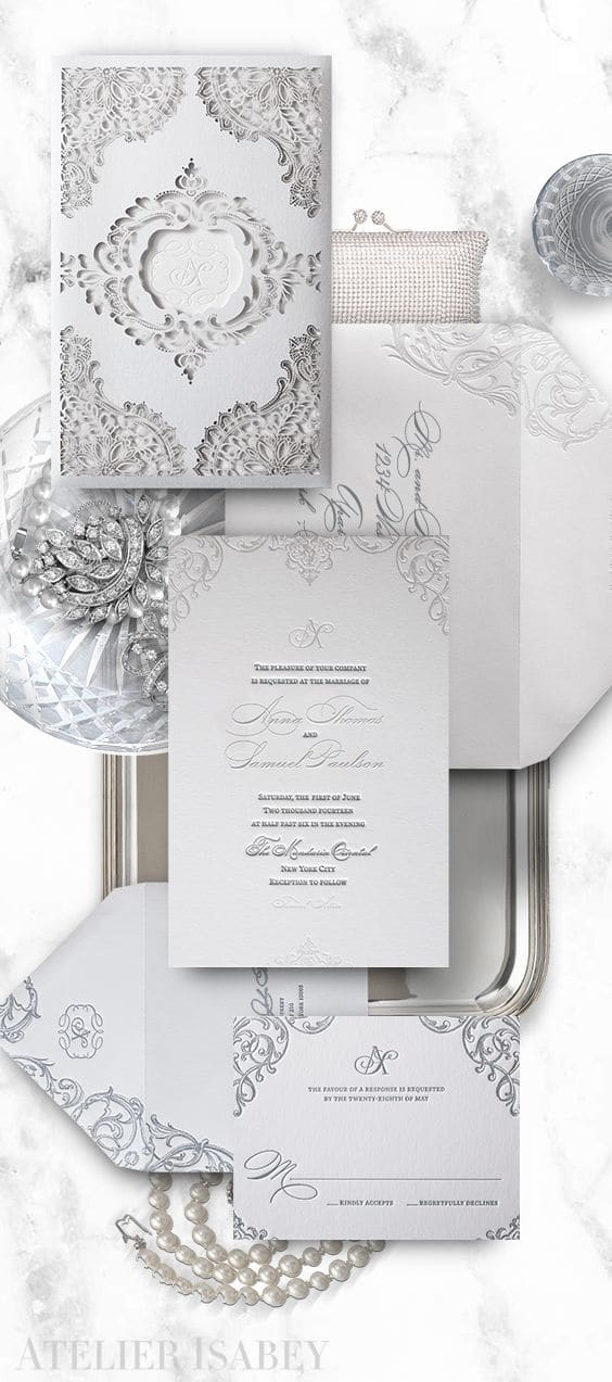 White wedding invitation with a laser cut lace sleeve | By Atelier Isabey