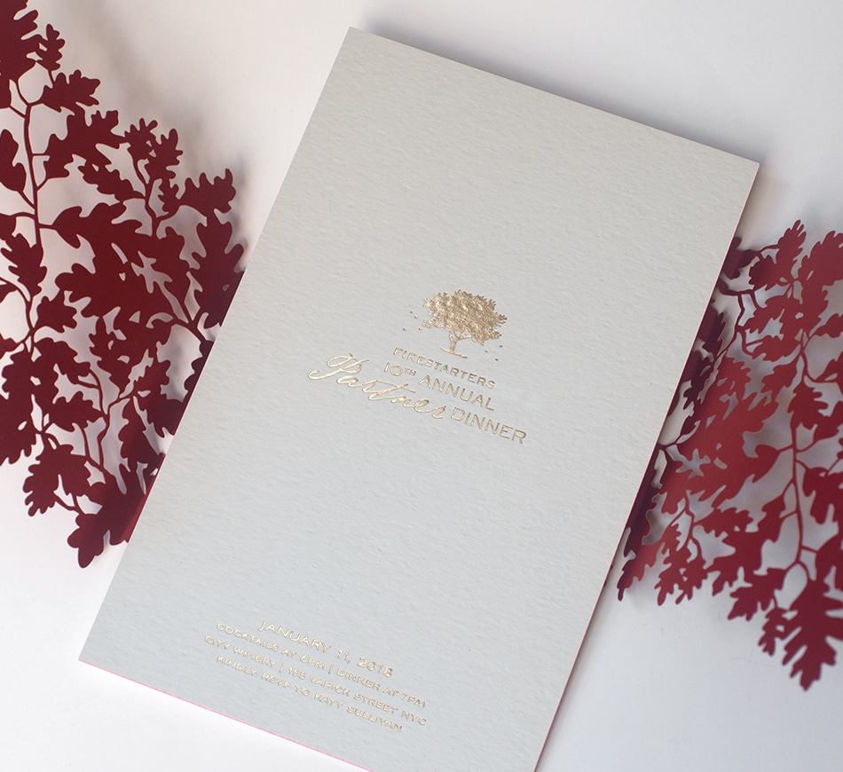 Gold foil invitation with tree and fireflies