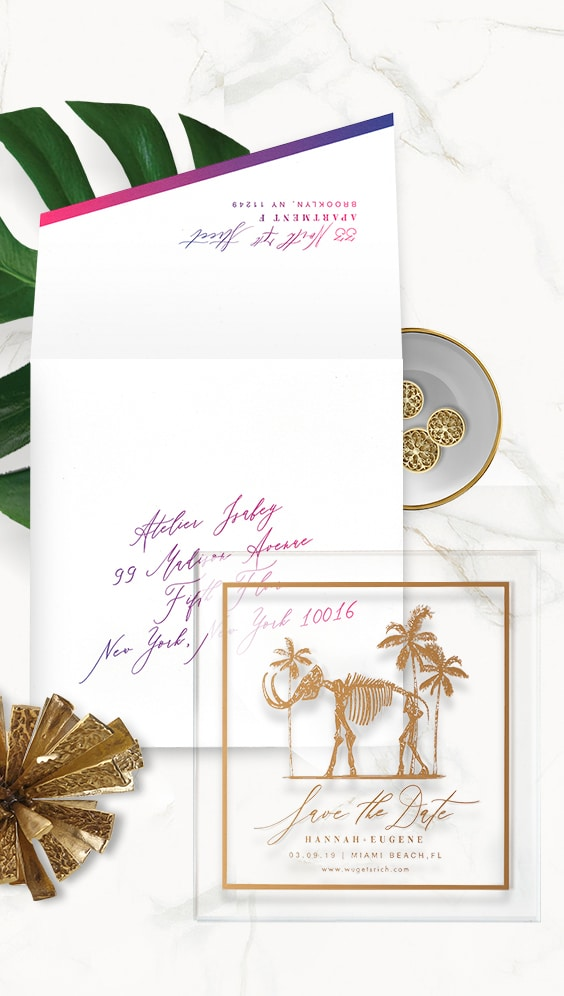Acrylic and gold foil save the date featuring the gold mammoth installation from the Faena hotel | By Atelier Isabey